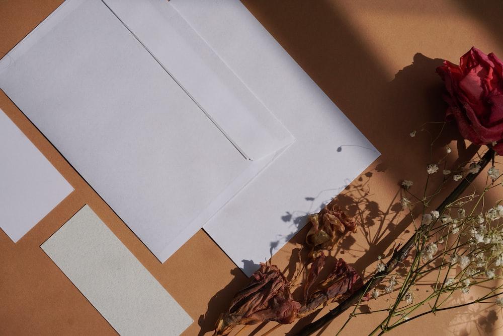 white printer paper on brown and white textile