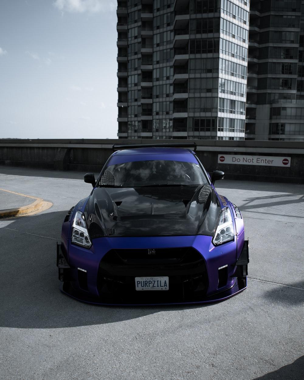 purple porsche 911 on road during daytime