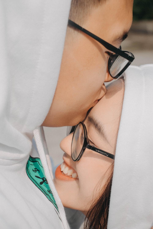 woman in white hoodie wearing black framed eyeglasses