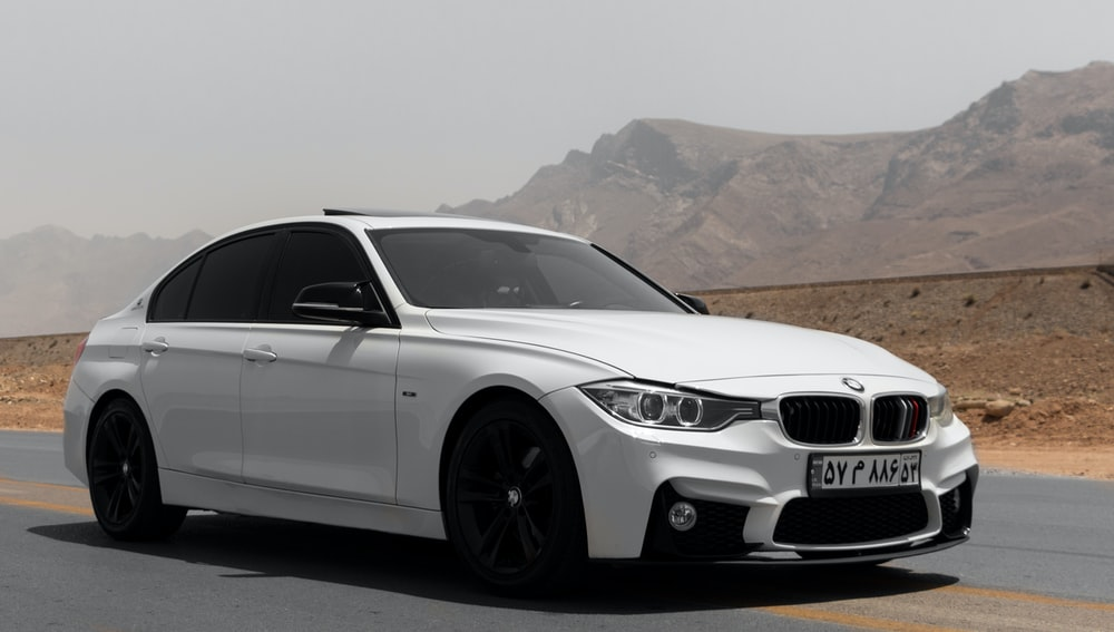 white bmw m 3 coupe on road during daytime