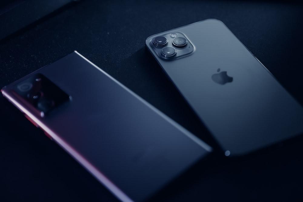 silver iphone 6 beside black iphone 4
