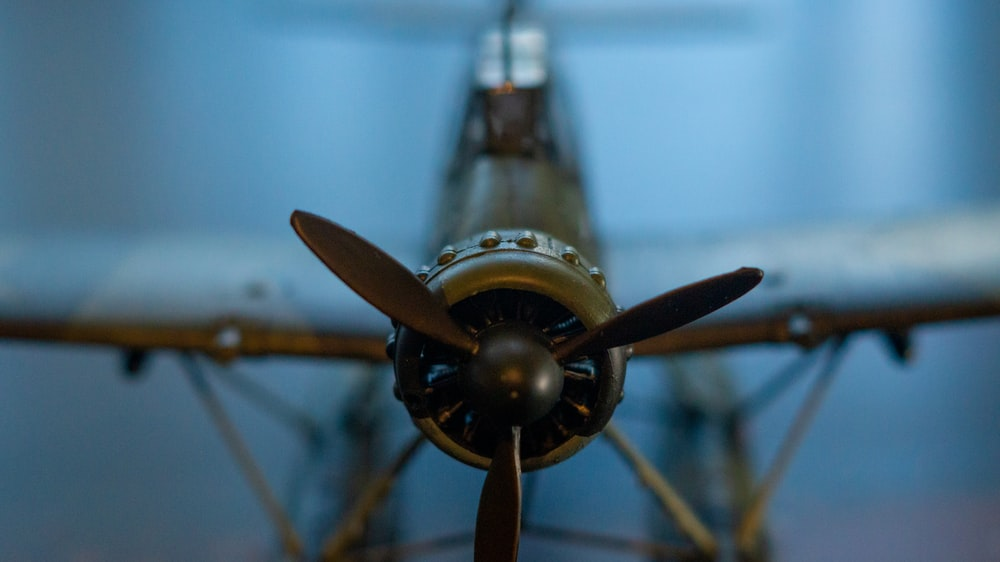 black and yellow propeller plane