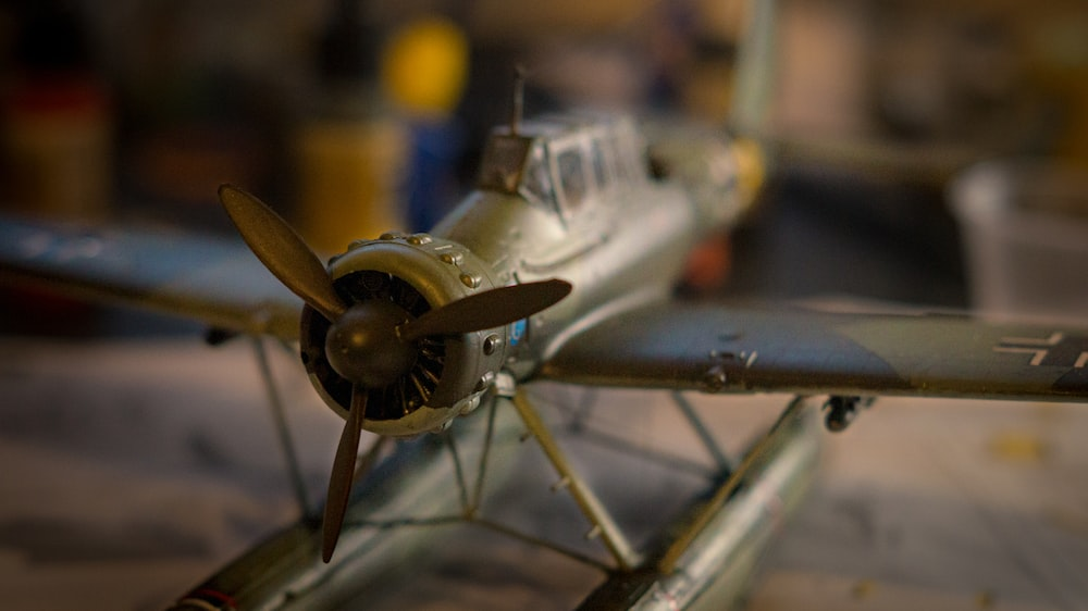 white and blue airplane scale model