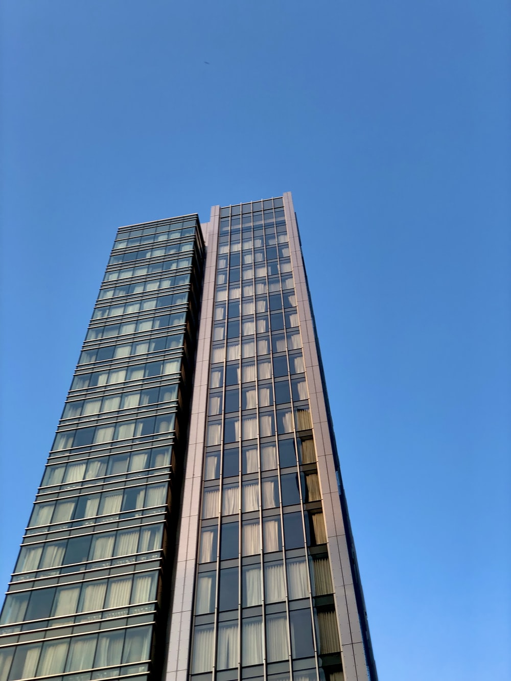 brown and white concrete building under blue sky during daytime
