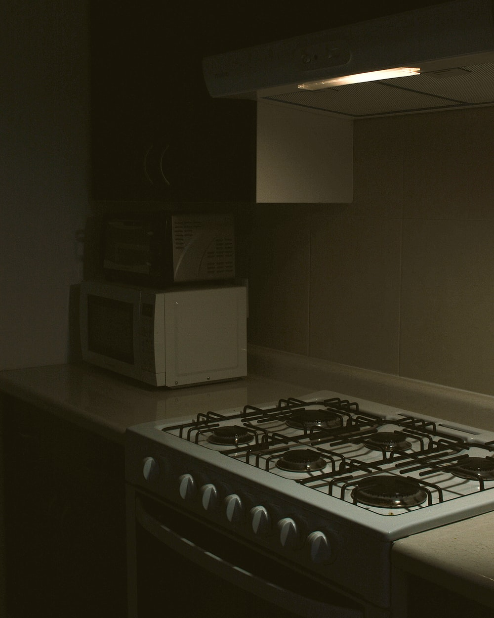 white microwave oven on black table
