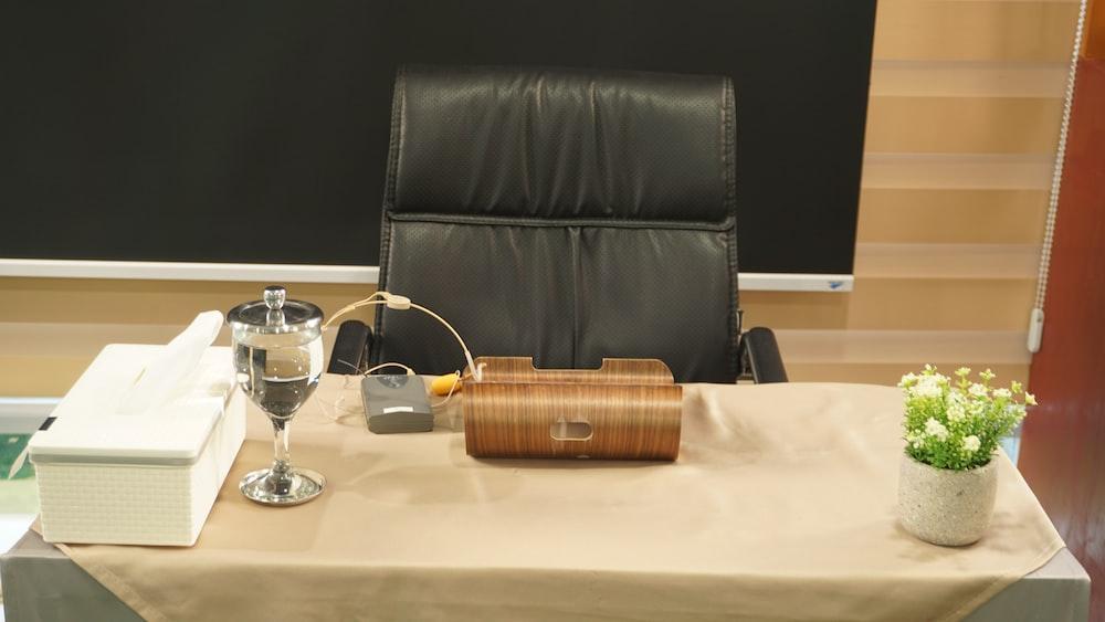 clear wine glass beside brown wicker basket on table