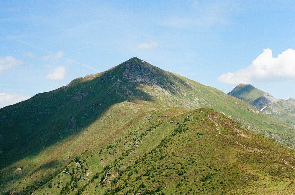green and brown mountain under blue sky during daytime