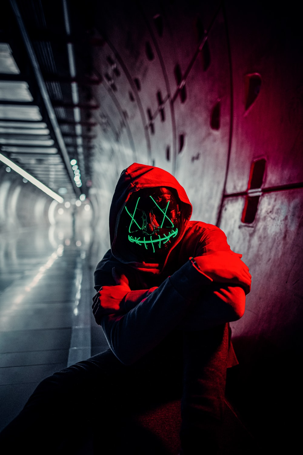 person in red hoodie wearing red mask