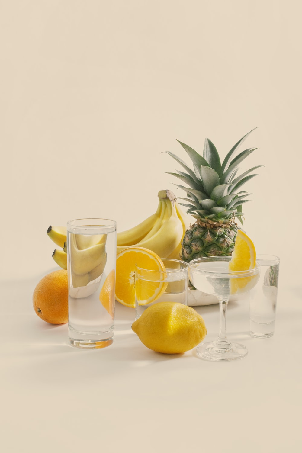 sliced lemon and clear drinking glass with sliced lemon