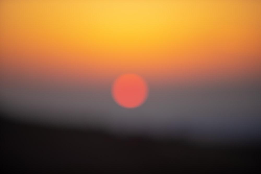 orange and yellow sun in the sky