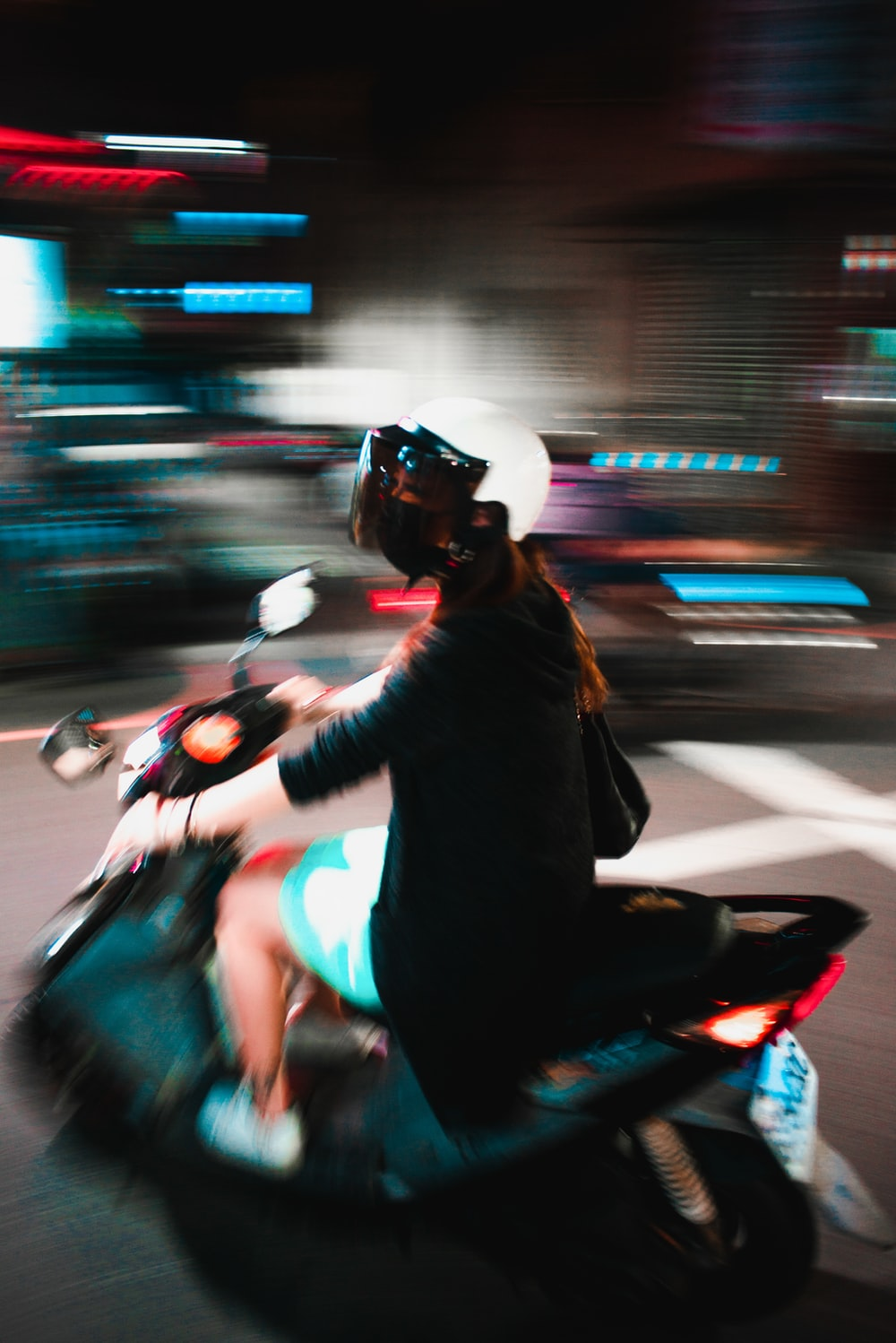 time lapse photography of man riding motorcycle during night time