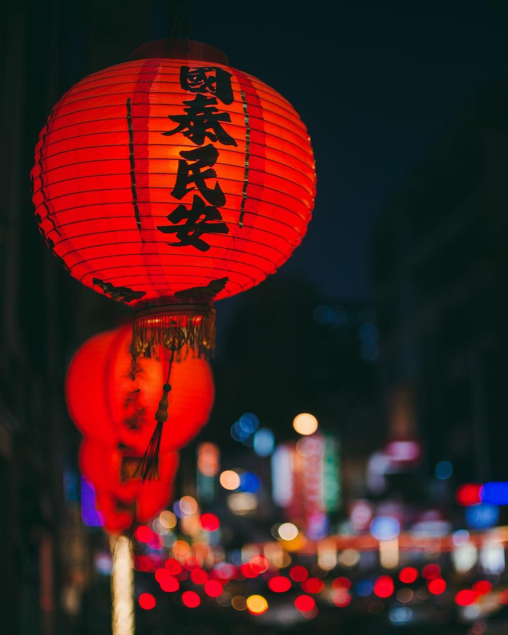 red chinese lantern during night time