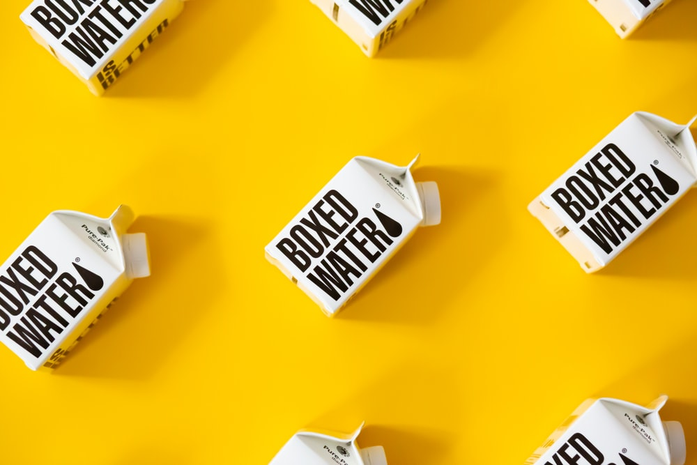 white and black calendar on yellow table