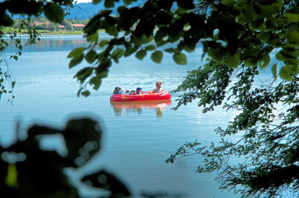 red kayak on body of water during daytime