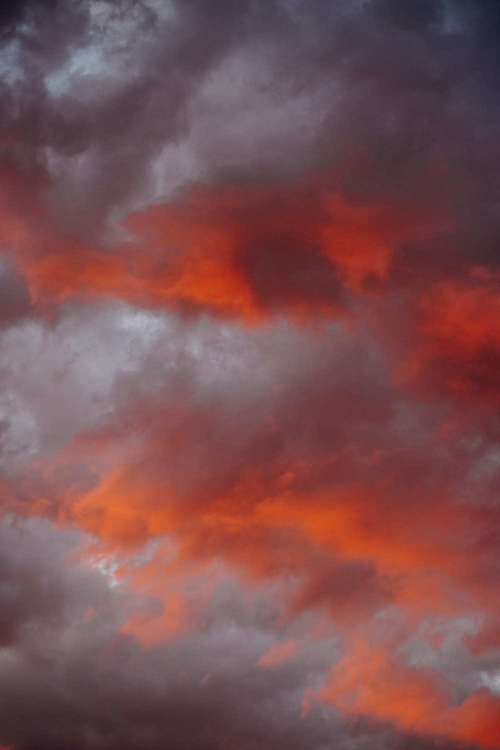red and black clouds during daytime