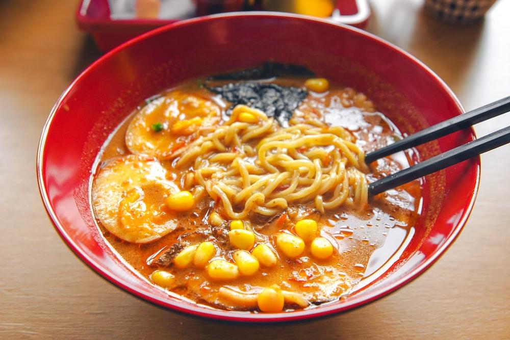 pasta dish on red ceramic bowl