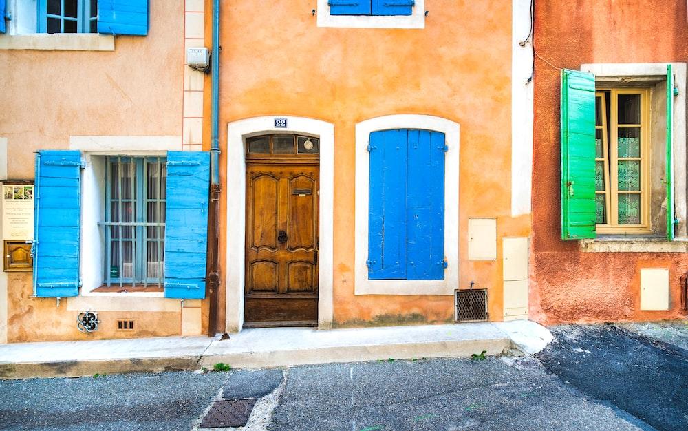 blue wooden door on brown concrete building