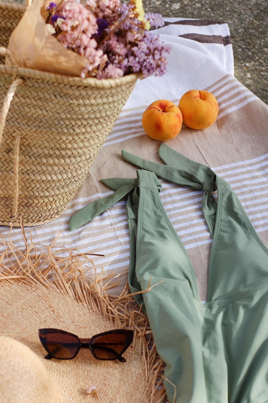 orange fruit on brown woven basket