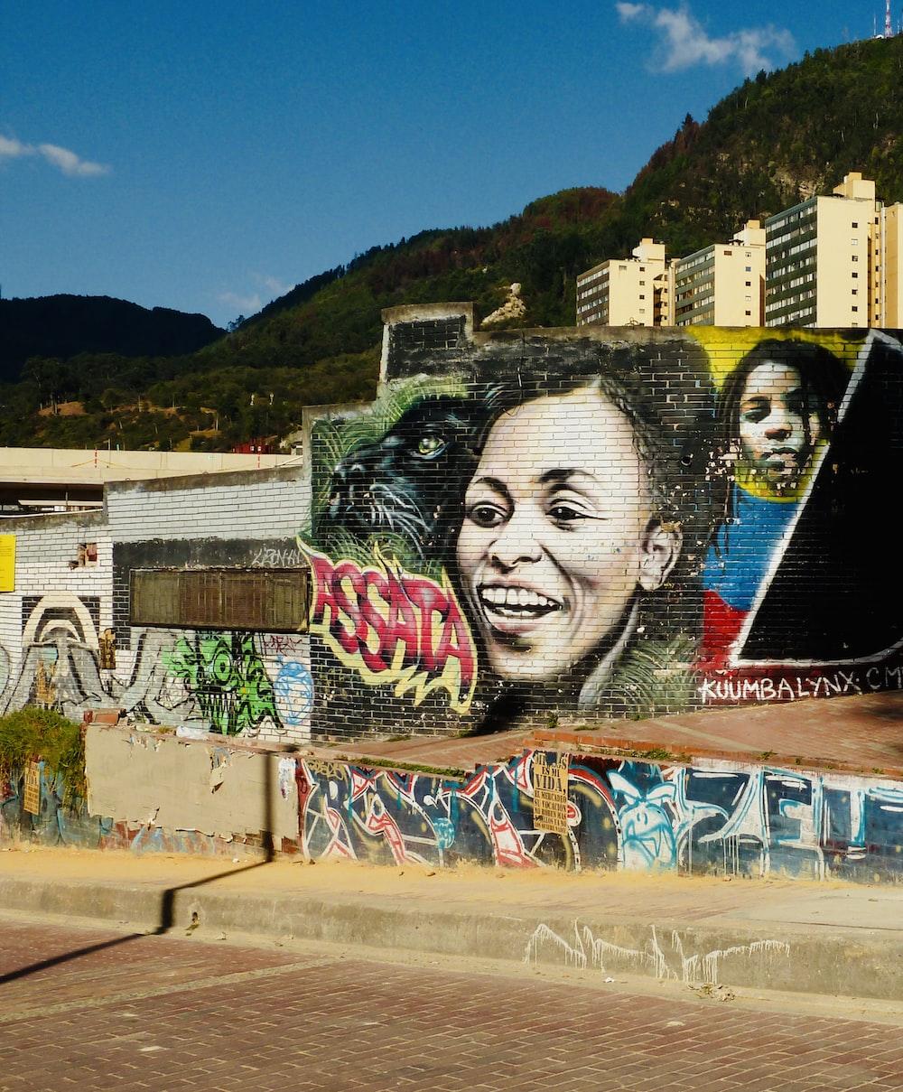 womans face graffiti on wall