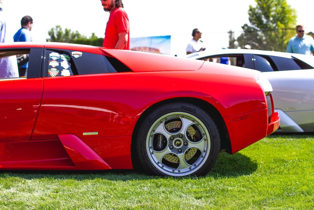 red ferrari 458 italia on green grass field