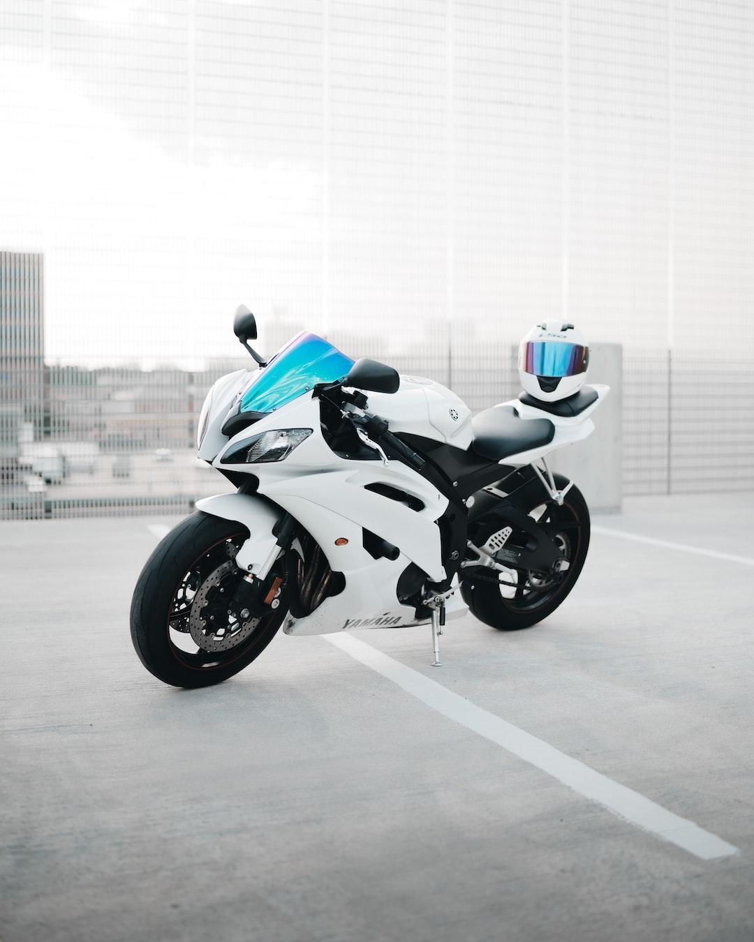 white and black sports bike