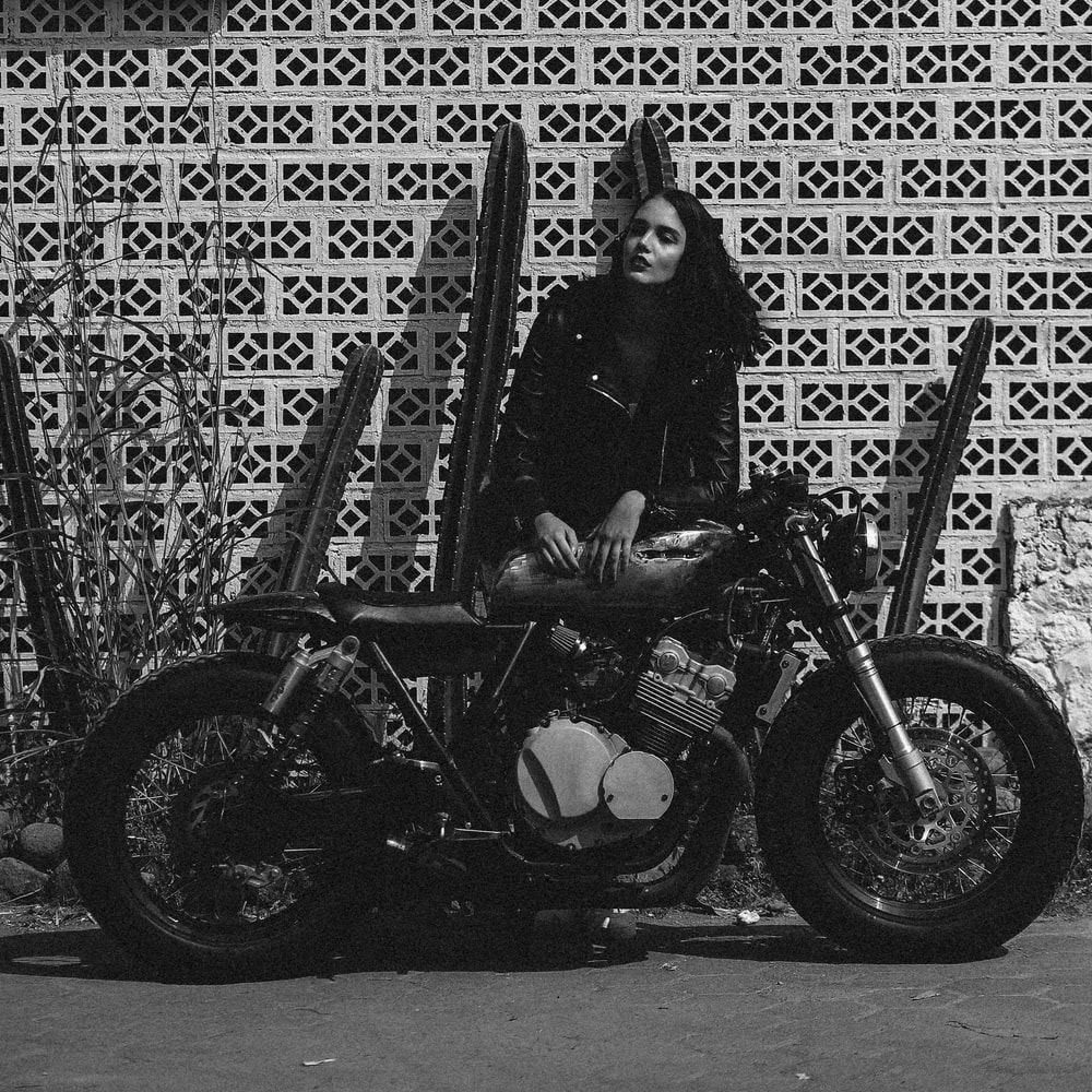 woman in black jacket riding motorcycle