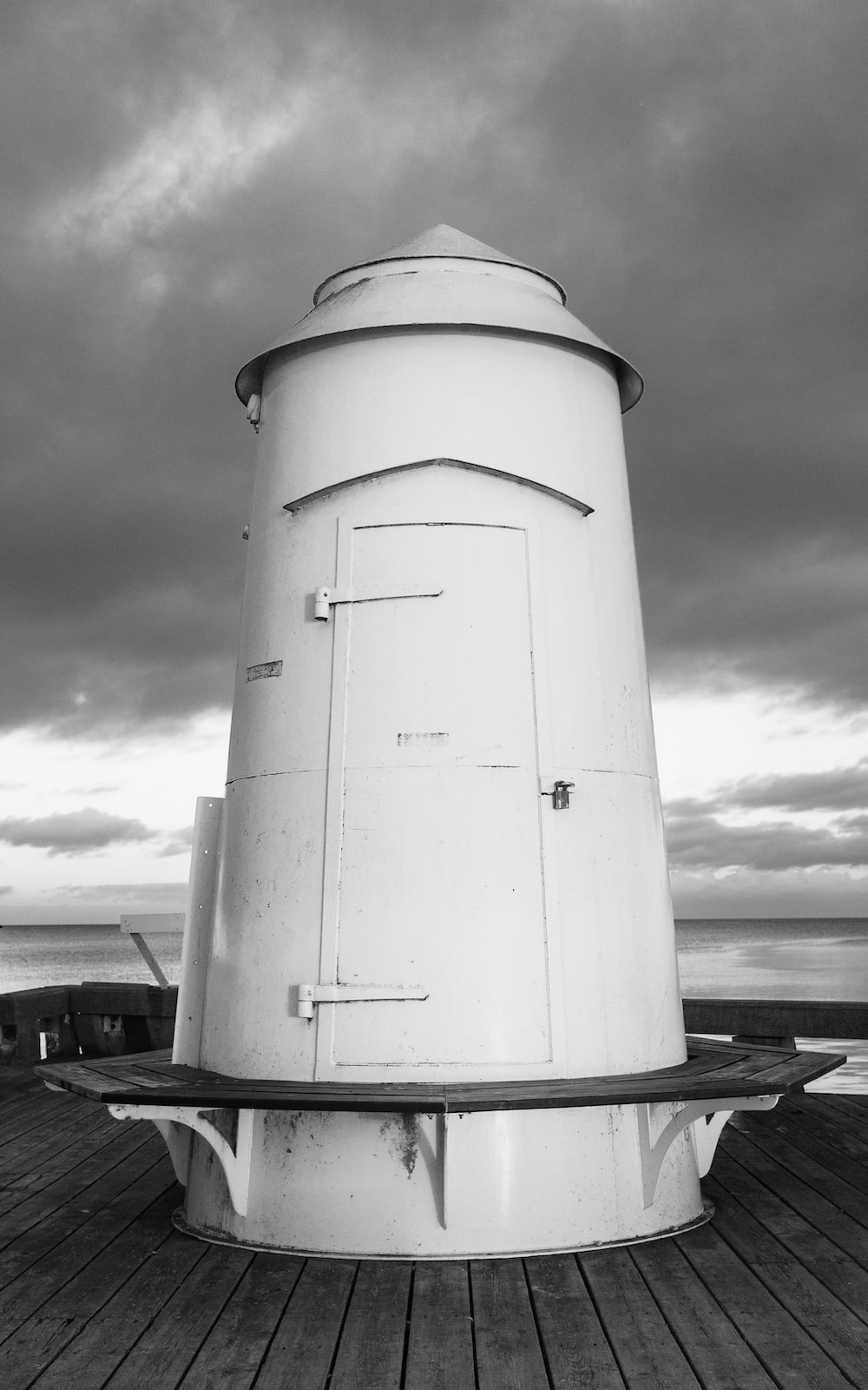 white lighthouse under cloudy sky during daytime