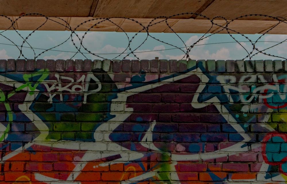 brown and green graffiti on wall