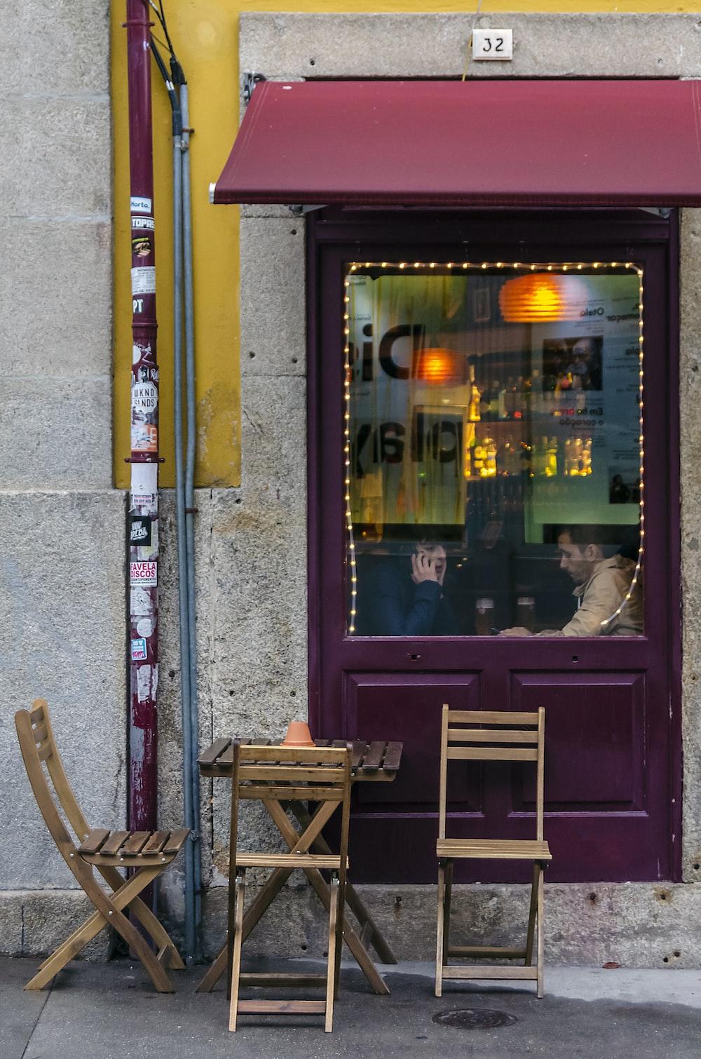 brown wooden chair beside brown wooden door