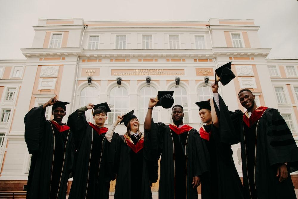 group of people in black academic dress