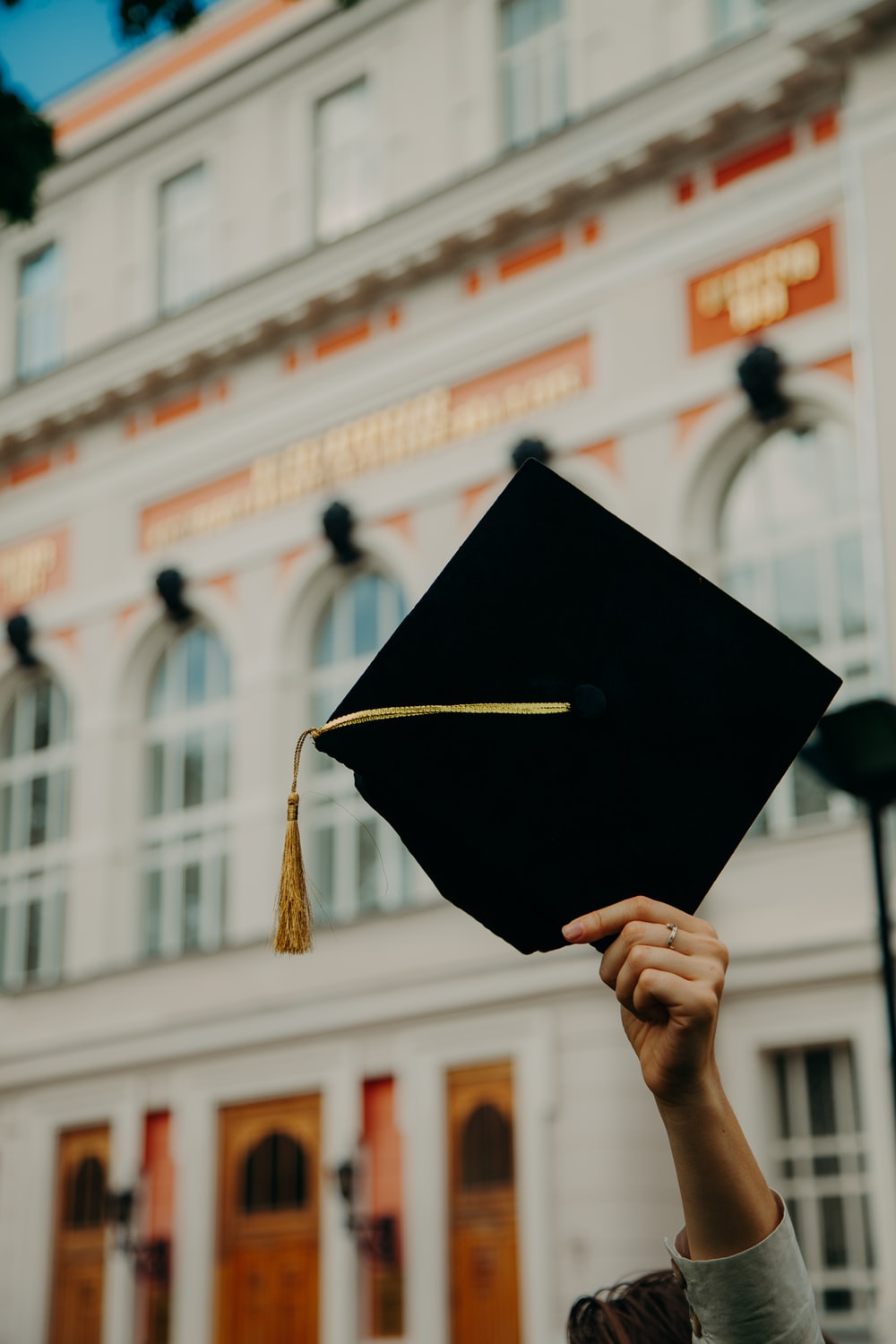 person holding black academic hat