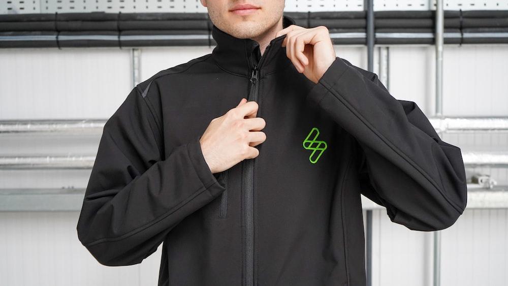 man in black nike hoodie standing near window