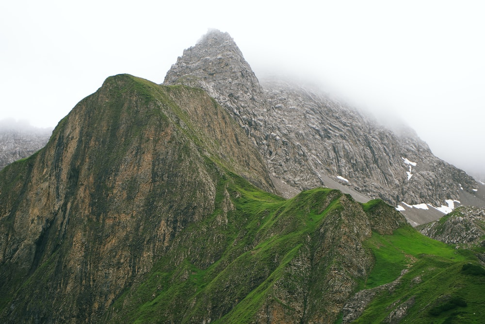 green and gray mountain under white sky during daytime