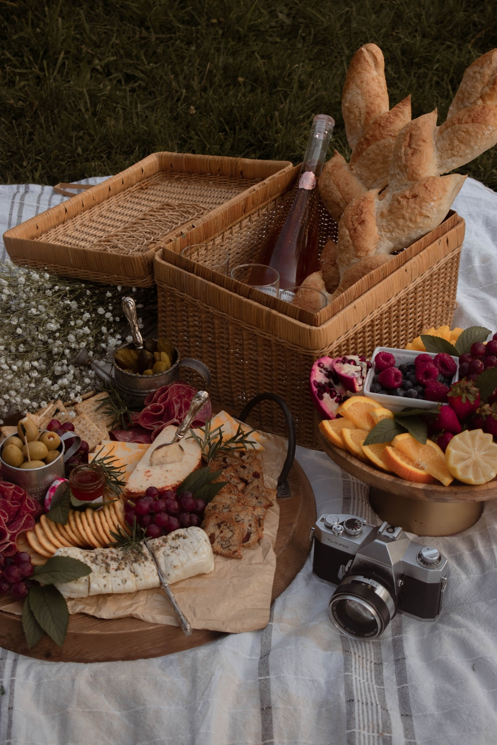 brown wicker basket with fruits and bread