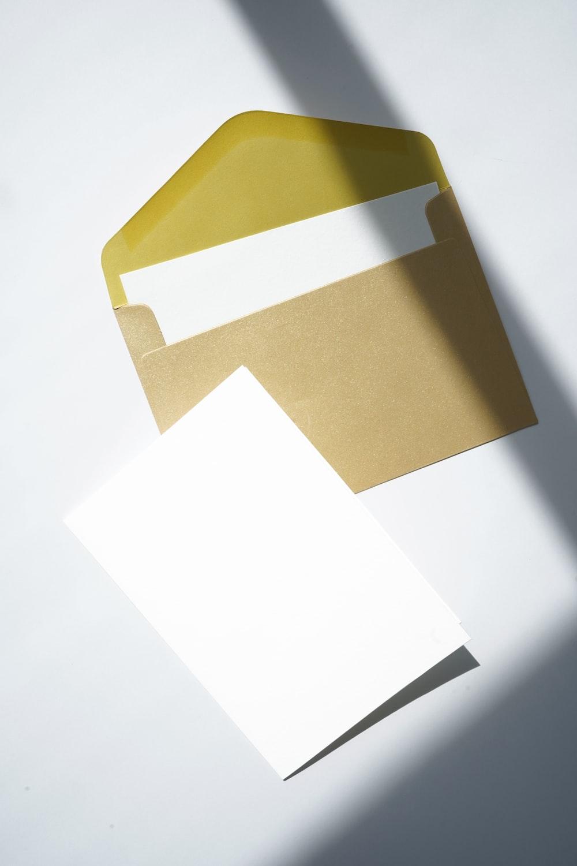 white printer paper on brown folder