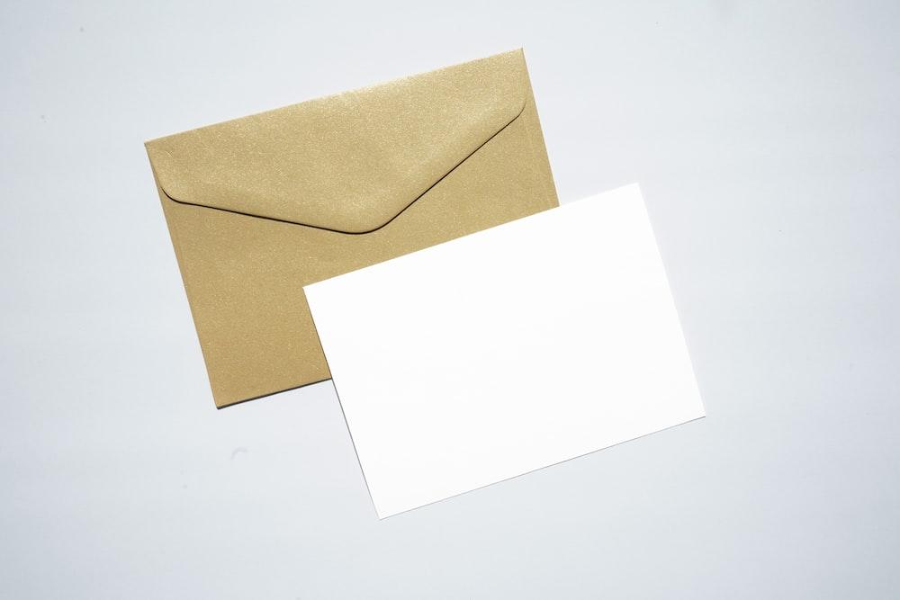 white printer paper on brown envelope