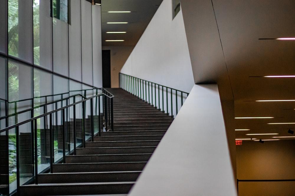 white concrete staircase with black metal railings