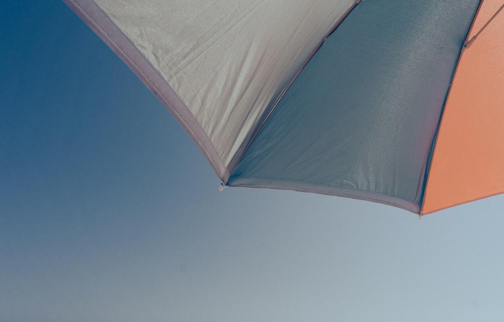 white umbrella under blue sky during daytime