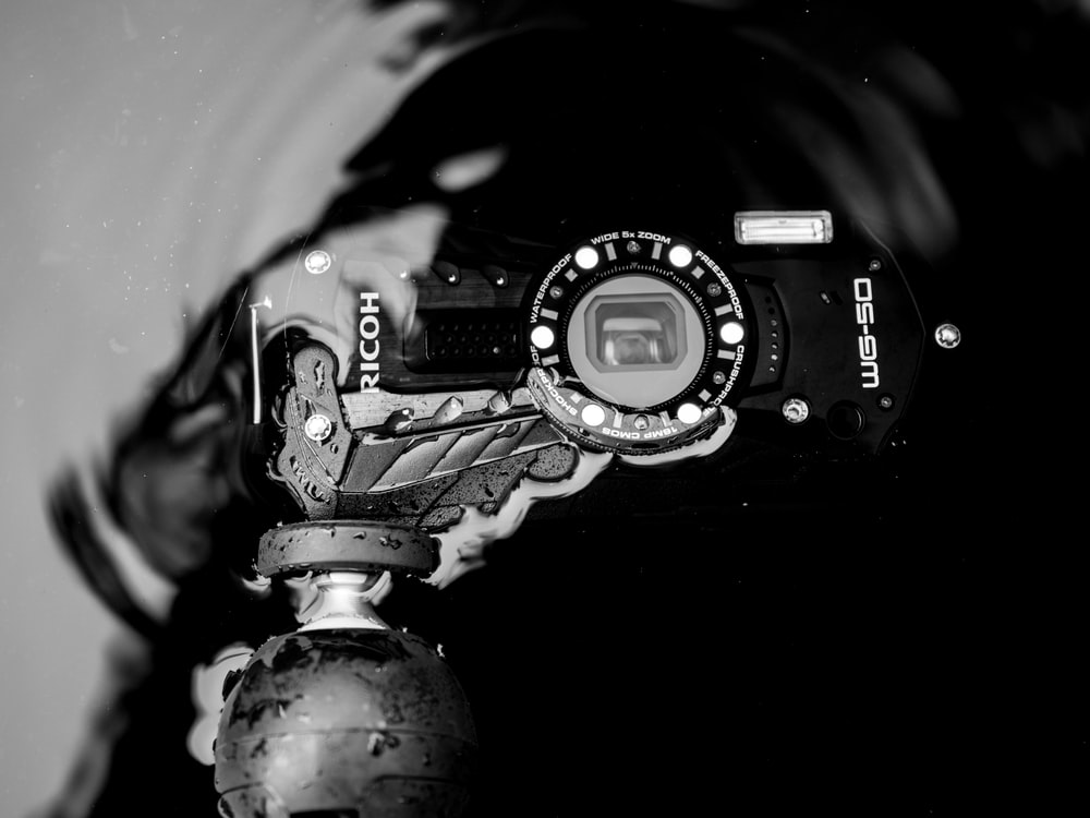 grayscale photo of a camera