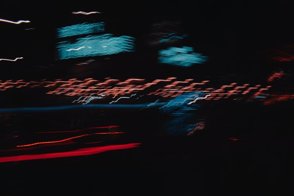 red and blue light on a dark room