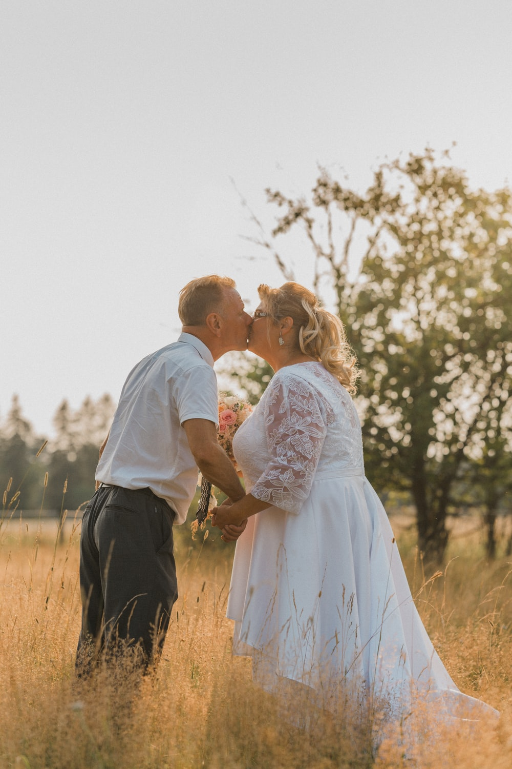 man in white dress shirt and woman in white dress