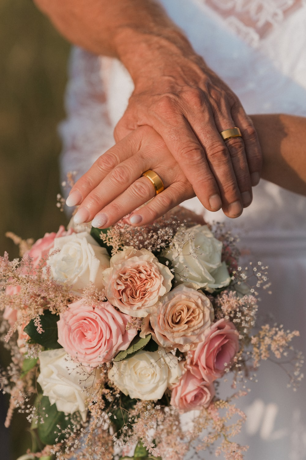 person holding bouquet of pink roses