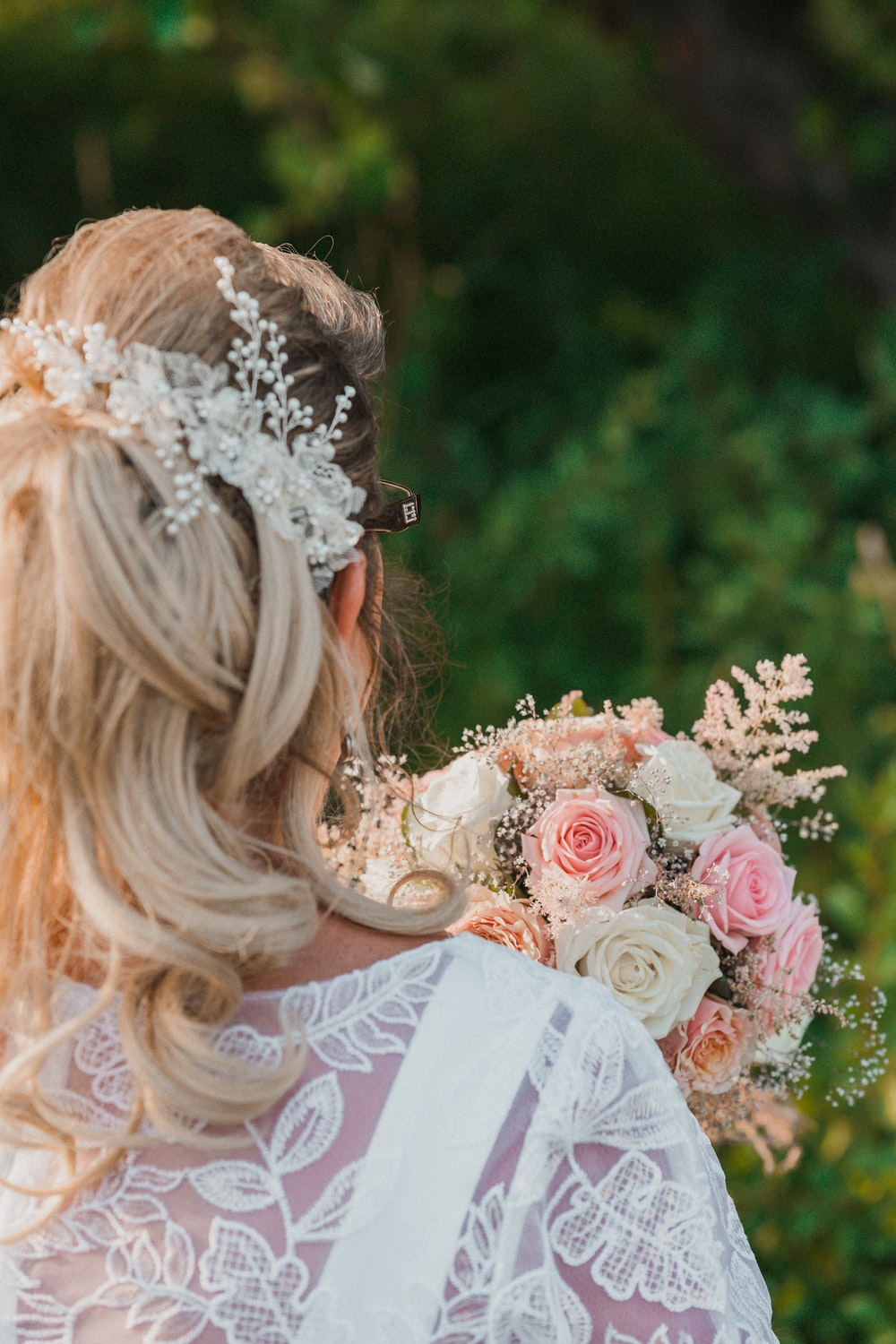 woman in white floral dress with white floral headband