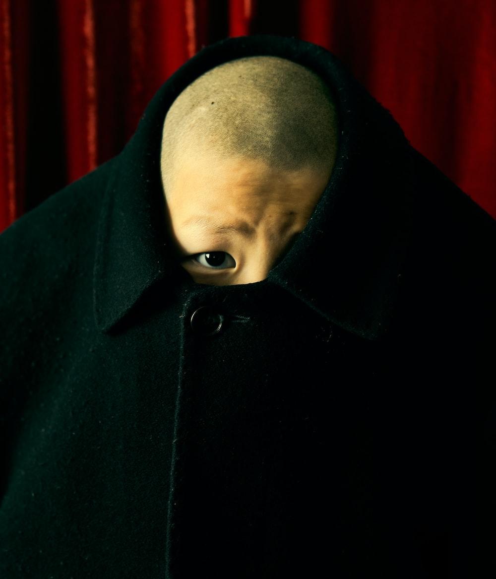 man in black hoodie standing