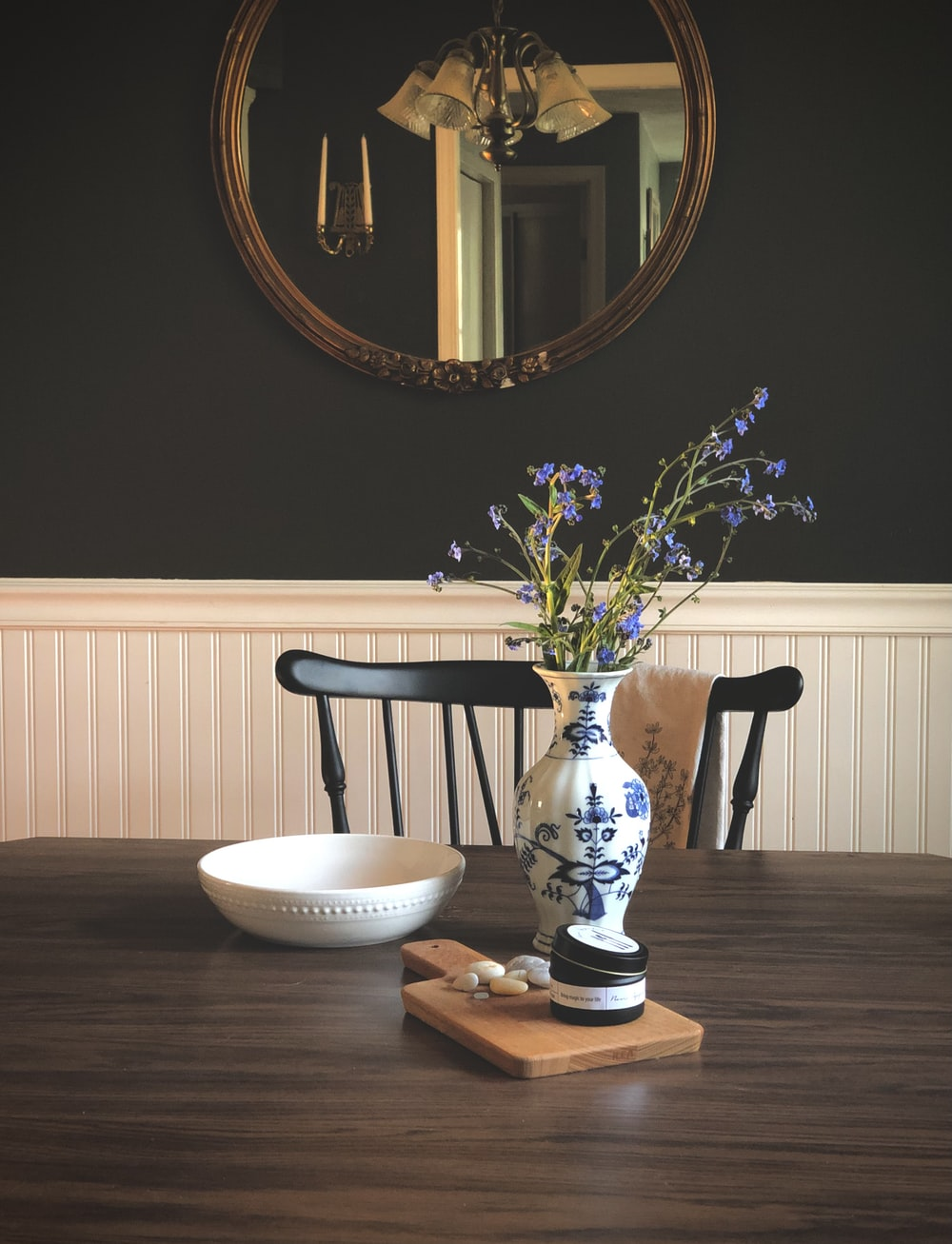 white ceramic bowl on brown wooden table