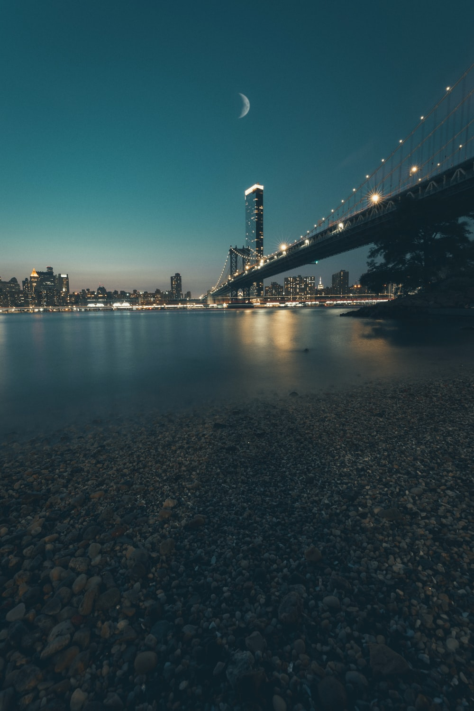 body of water near bridge during night time