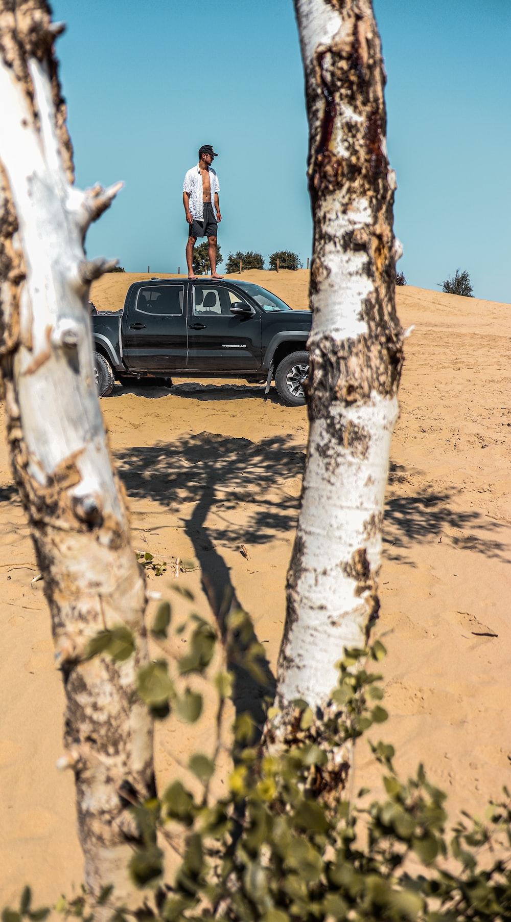 black suv on brown sand during daytime