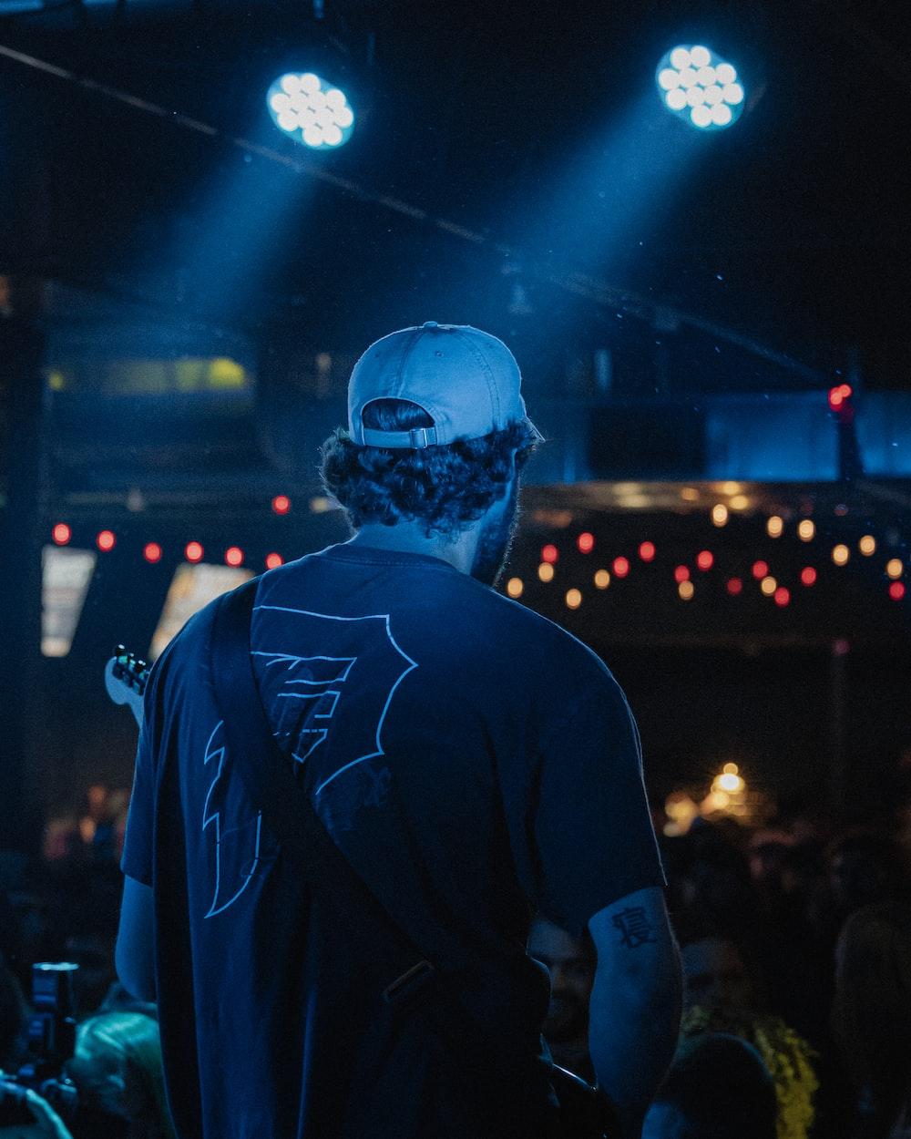 man in black crew neck t-shirt wearing blue helmet and blue helmet