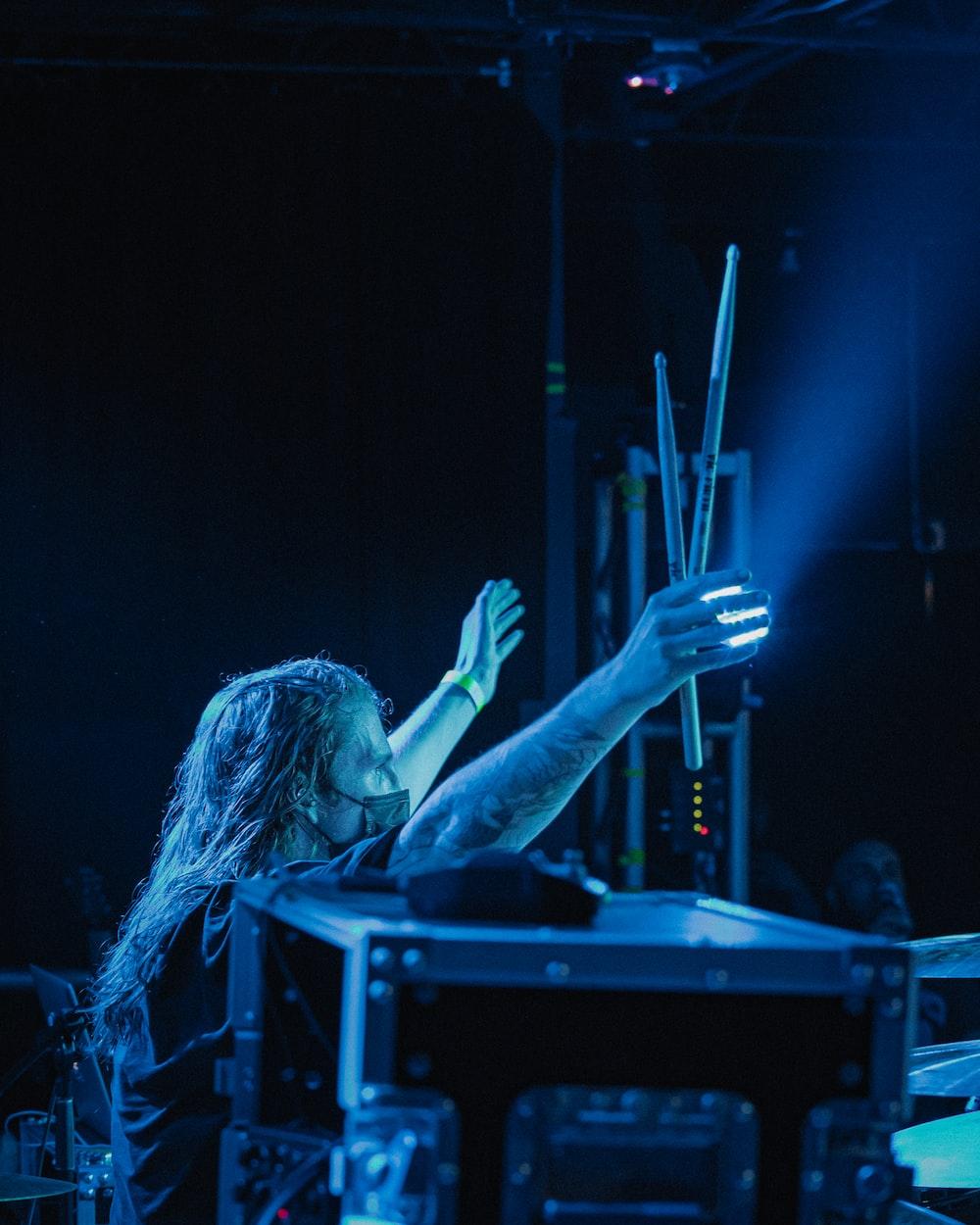 woman in black shirt raising her right hand