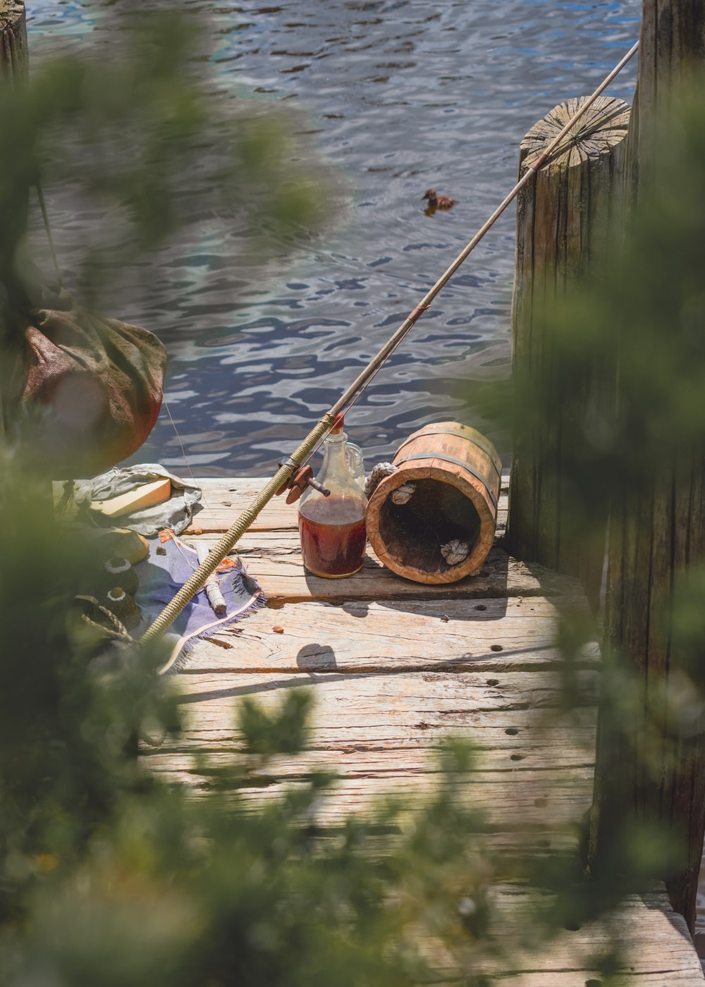 brown wooden fishing rod on brown wooden dock